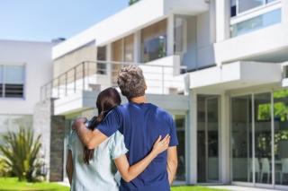 couple admiring a home