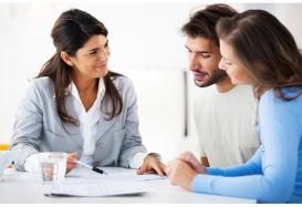 couple with loan advisor