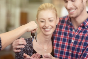 New homebuyers receiving keys