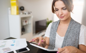 Woman looking over Credit Report.