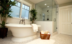 Updated bathroom with white tile.