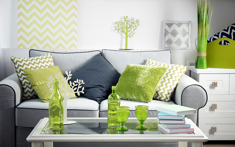 Living room with green accent pieces