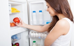 Woman looking into fridge.
